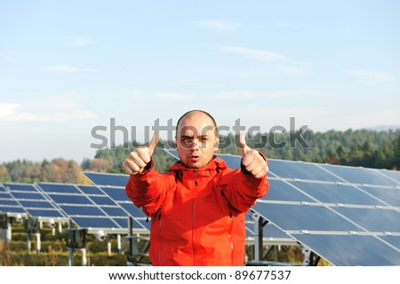 Male worker at solar panel field - stock photo