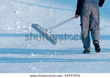 Male worker cleaning the road from the snow - stock photo