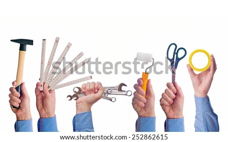 Male worker's hand holding various crafts trade tools. Part of series set of images with DIY tools for home jobs and crafts in hand isolated on white background. - stock photo
