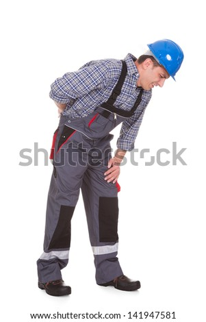 Male Worker Suffering With Pain Over White Background - stock photo