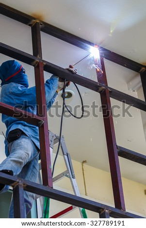 male workers were welding on the high danger no safety