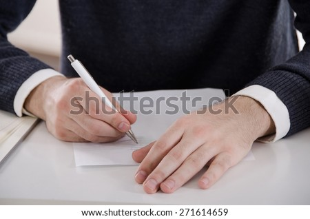 Male Writing Hands - stock photo