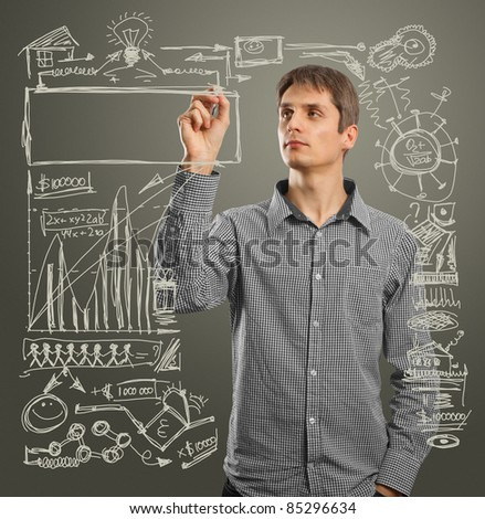 male writing something on glass board with marker