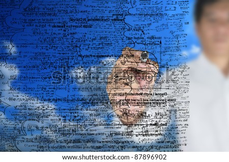 male writing something on glass board with marker - stock photo
