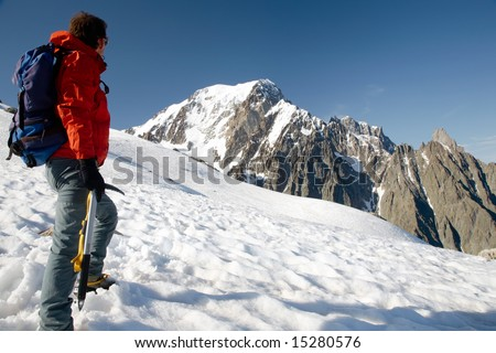 Male young climber standing in front of south side of Mont Blanc; Italy - France - stock photo