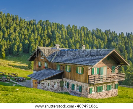 Malga Brogles refuge, located at the foot of Odle mountain group, in Puez-Odle nature park, offers great views of the Fermeda towers and Sas Rigais summit, Val di Funes, Dolomites, South Tyrol, Italy