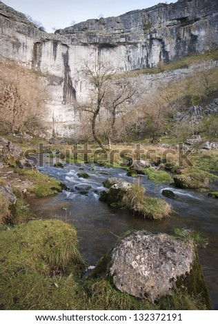 Malham Beck and Malham Cove in Yorkshire Dales National Park - stock photo