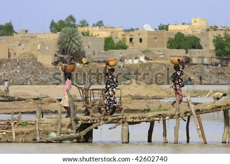 MALI - AUGUST 16: Women carrying cargo, the port of Mopti is the most important country in freight, August 16, 2009 in Mopti, Mali - stock photo