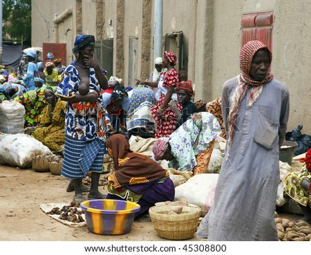 MALI - AUGUST 17: Women in the market of Djenne, Monday marks one of the largest markets in Mali near the great mosque, August 17, 2009 in Djenne, Mali