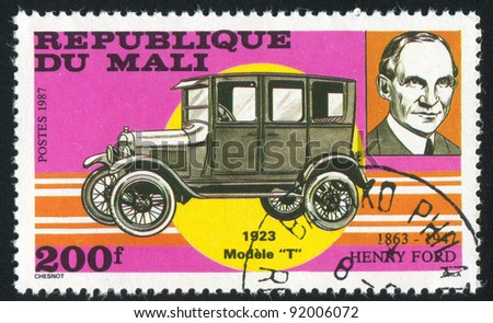 MALI - CIRCA 1987: stamp printed by Mali, shows Henry Ford and automobile, circa 1987 - stock photo