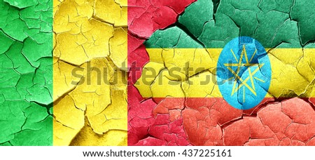 Mali flag with Ethiopia flag on a grunge cracked wall - stock photo