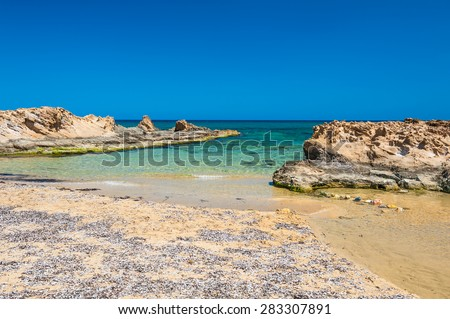 Malia beach, Crete island, Greece. Beautiful beach with clear turquoise water and rocks - stock photo