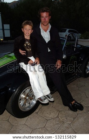 "MALIBU, CA - AUGUST 05: Dean McDermott and son Jack Montgomery at ""Bow Wow Ciao"" to Benefit Much Love Animal Rescue on August 05, 2006 at John Paul and Eloise Dejoria Estate in Malibu, CA. - stock photo"