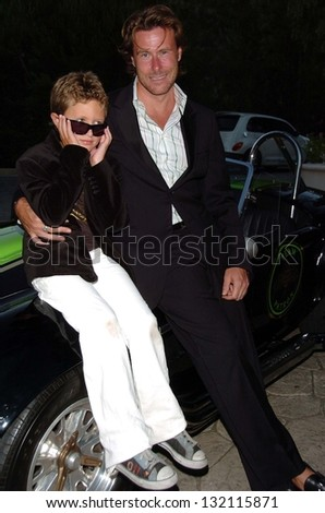 "MALIBU, CA - AUGUST 05: Dean McDermott and son Jack Montgomery at ""Bow Wow Ciao"" to Benefit Much Love Animal Rescue on August 05, 2006 at John Paul and Eloise Dejoria Estate in Malibu, CA."