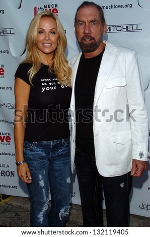 "MALIBU, CA - AUGUST 05: Eloise DeJoria and John Paul DeJoria at ""Bow Wow Ciao"" to Benefit Much Love Animal Rescue on August 05, 2006 at John Paul and Eloise Dejoria Estate in Malibu, CA. - stock photo"