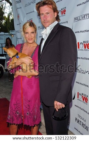 "MALIBU, CA - AUGUST 05: Tori Spelling and Dean McDermott at ""Bow Wow Ciao"" to Benefit Much Love Animal Rescue on August 05, 2006 at John Paul and Eloise Dejoria Estate in Malibu, CA. - stock photo"
