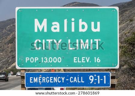 Malibu, California, USA - April 14, 2015:  Malibu city limit sign on busy Pacific Coast Highway in Southern California.   - stock photo