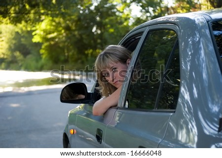 Malicious girl-driver looks in the chamber - stock photo