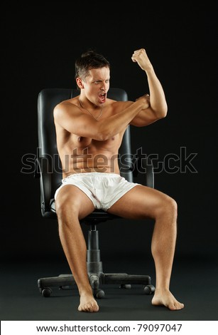 malicious man sitting on a chair, dismissed worker, chief orders subordinates - stock photo