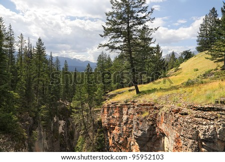 Maligne canyon between Rocky mountains covered with coniferous wood in Jasper National Park (Alberta, Canada) - stock photo