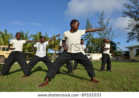 MALINDI,KENYA-16 OCTOBER:  a group of unidentified orphans learn martial arts discipline.The Italian Association Rizzato, follows the children in the discipline, Malindi October 16.2011 - stock photo