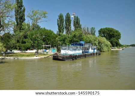MALIUC - JUNE 22: Arriving ship at the boat station of Maliuc, on river Danube. Maliuc is one of the oldest communes in the Danube delta. On June 22 in Maliuc, Romania