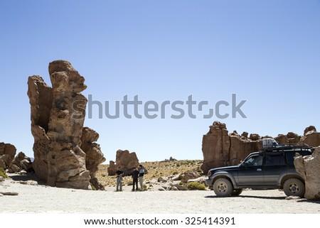 Mallku Villamar, Bolivia - September 15, 2015: Tourists in expedition at Atacama Desert. - stock photo