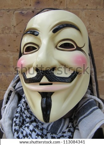 MALLORCA - MAY 15: Masked member of Anonymous in the demonstrations against the economic crisis and social injustice in the Plaza de Espana in Palma de Mallorca, Spain on May 15, 2012 - stock photo