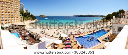 MALLORCA, SPAIN - MAY 29: The tourists enjoiying their vacation on the beach on May 29, 2015 in Mallorca, Spain. Up to 60 mln tourists is expected to visit Spain in year 2015. - stock photo