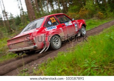 MALLOW, IRELAND - MAY 19: A. Commins driving Ford Escort at the Jim Walsh Cork Forest Rally on May 19, 2012 in Mallow, Ireland. 4th round of the Valvoline National Forest Rally Championship.