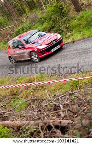 MALLOW, IRELAND - MAY 19: D. Cronin driving Peugeot 206 at the Jim Walsh Cork Forest Rally on May 19, 2012 in Mallow, Ireland. 4th round of the Valvoline National Forest Rally Championship.