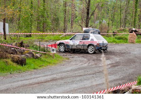 MALLOW, IRELAND - MAY 19: I. Downey driving Opel Corsa at the Jim Walsh Cork Forest Rally on May 19, 2012 in Mallow, Ireland. 4th round of the Valvoline National Forest Rally Championship.