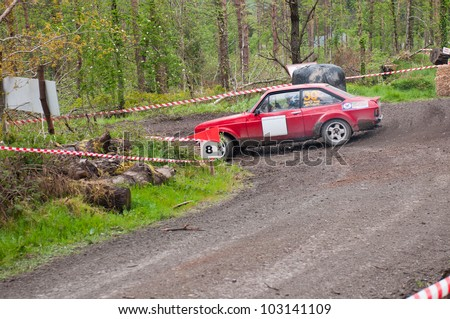MALLOW, IRELAND - MAY 19: J. Cullinane driving Ford Escort at the Jim Walsh Cork Forest Rally on May 19, 2012 in Mallow, Ireland. 4th round of the Valvoline National Forest Rally Championship.