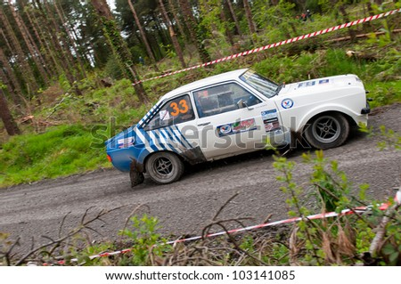 MALLOW, IRELAND - MAY 19: S. Benskin driving Ford Escort at the Jim Walsh Cork Forest Rally on May 19, 2012 in Mallow, Ireland. 4th round of the Valvoline National Forest Rally Championship. - stock photo