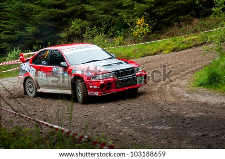 MALLOW, IRELAND - MAY 19: S. Wright driving Mitsubishi Evo at the Jim Walsh Cork Forest Rally on May 19, 2012 in Mallow, Ireland. 4th round of the Valvoline National Forest Rally Championship.