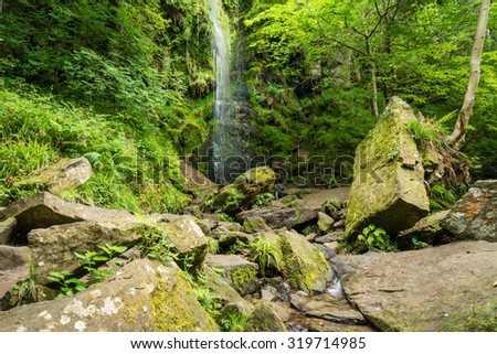 Mallyan Spout Waterfall / Mallyan Spout waterfall at Goathland in the North York Moors National Park flows into West Beck which has created a deep gorge - stock photo