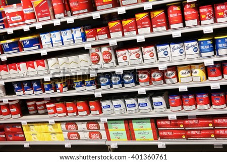 MALMEDY, BELGIUM - JULY 27, 2015: Tobacco store. Aisle with Tobacco packings for a home Cigarette tubing machine in a Carrefour Hypermarket. a French multinational retailer, and hypermarket chain.