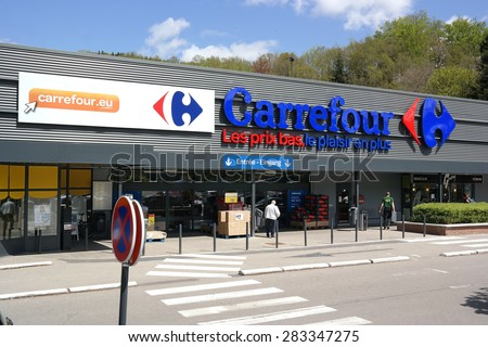 MALMEDY, BELGIUM - MAY 7: Entry of a Carrefour hypermarket, a French multinational retailer, and one of the largest hypermarket chains in the world. Photo taken on May 7, 2015 in Malmedy, Belgium - stock photo