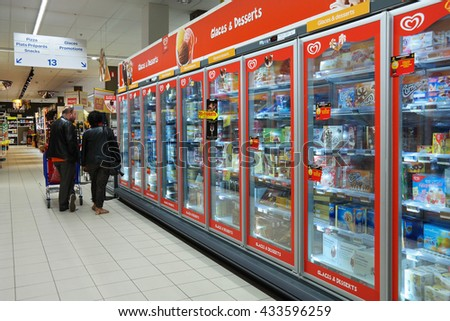 MALMEDY, BELGIUM - MAY 4, 2016: Freezer department with Ice cream of Unilever Heartbrand in a Carrefour Hypermarket. Unilever is the world's biggest ice cream manufacturer. - stock photo