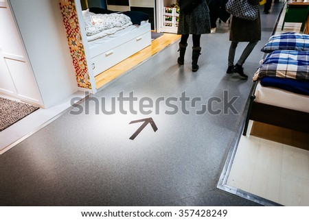 MALMO, SWEDEN - JANUARY 2, 2015: Interior of large IKEA store with a wide range of products in Malmo, Sweden. Direction instructions. Ikea is the world's largest furniture retailer. - stock photo