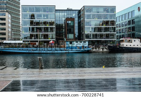 Malmo, Sweden - July 25, 2017: Malmo cityscape, steel and glass building of Malmö University, canal waterfront