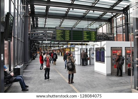MALMO, SWEDEN - MARCH 12: Travelers wait at the Central railway station on March 12, 2011 in Malmo, Sweden. With 45,000 passengers daily it is one of the busiest stations in Sweden. - stock photo