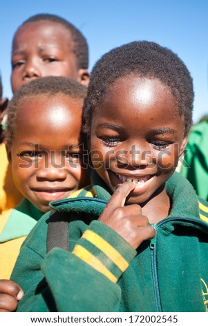 MALOLOTJA, SWAZILAND-JULY 31: Unidentified orphan pupil on July 31, 2008 in Malolotja Government School, Malolotja, Swaziland. Close to 10% of Swaziland's population are orphans, due to HIV/AIDS. - stock photo