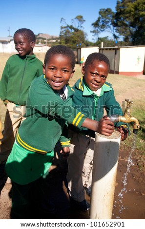 MALOLOTJA, SWAZILAND-JULY 31: Unidentified orphan schoolboys on July 31, 2008 in Malolotja Government School, Malolotja, Swaziland. Close to 10% of Swaziland�s population are orphans, due to HIV/AIDS. - stock photo