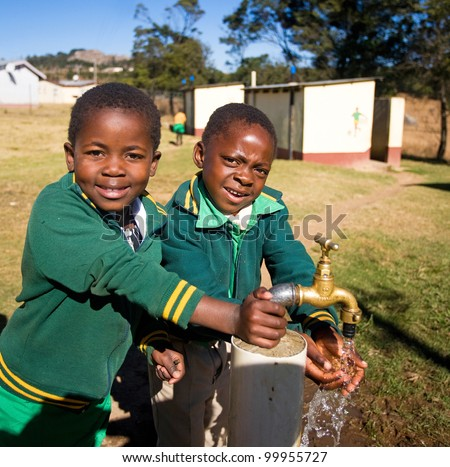 MALOLOTJA, SWAZILAND-JULY 31: Unidentified orphan schoolboys on July 31, 2008 in Malolotja Government School, Malolotja, Swaziland. Close to 10% of Swazilands population are orphans, due to HIV/AIDS.