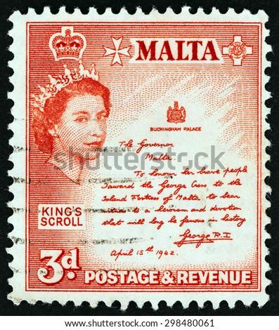MALTA - CIRCA 1956: A stamp printed in Malta shows King's Scroll, circa 1956. - stock photo