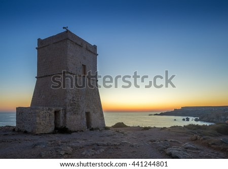 Malta, G?ajn Tuffie?a Tower at sunset with clear blue sky - stock photo
