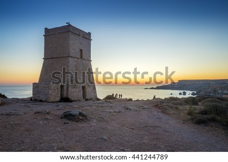 Malta, G?ajn Tuffie?a Tower at sunset with tourists and clear blue sky - stock photo