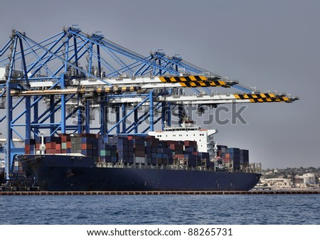Malta Island, Marsaxlokk, cargo ships loading factory - stock photo