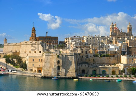 Malta, Valetta harbor, The Three Cities; a view to Cospicua from high up in Vittoriosa on a sunny day - stock photo